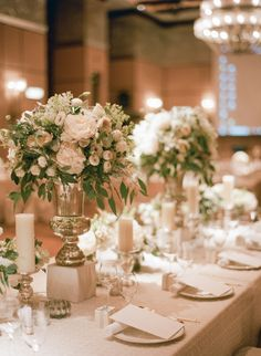 Centerpieces of Ivory Roses in Silver | photography by http://www.jadapoonphotography.com/