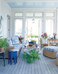Walters Wicker Seagrass sofa and armchairs covered in a Brunschwig & Fils cornflower blue and white plaid make the screened porch an inviting family gathering place. Ceiling color is Morning Glory by Benjamin Moore.   - HouseBeautiful.com