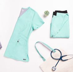 The Marquis V-neck scrub top flatters with ultra-feminine princess seams and angled strapping detail. This solid scrub top features a tagless collar and a binded V neckline lies flat to lend you a polished, professional appearance. Key to its wearability is the innovative arcLux™ Technology, a super-soft fabric designed to ensure the utmost comfort for whatever the workday throws your way. Plus, with three pockets at the ready, there's plenty of room to stash your cellphone and accessories. Scrubs Outfit, Scrubs Uniform, Medical Scrubs, Nursing Scrubs, Greys Anatomy Mens Scrubs, Landau Scrubs, Scrub Shop, Nursing Accessories, Cute Scrubs
