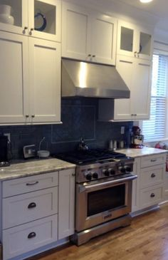 Stainless and Elegance! Designed by Tricia Lichtle of C&M Cabinets and Granite