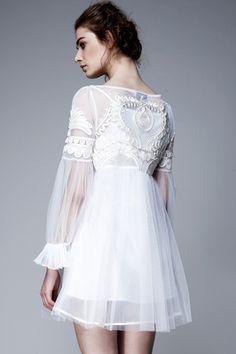 Short white lacy dress.