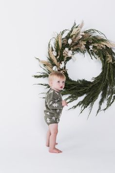 The wreath. Cedar branches and pampas grass mixed in