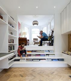 Books can be stored beneath the wide steps of this staircase.