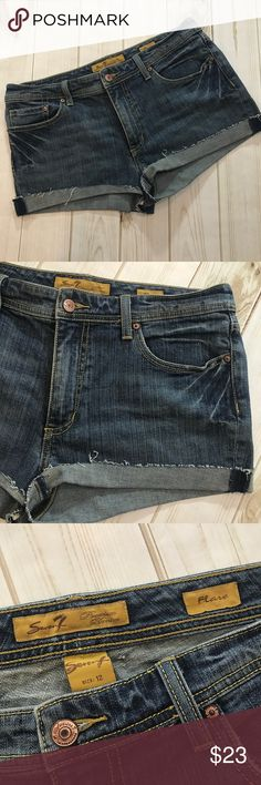 Seven 7 Denim Cutoff Shorts, Women's Size 12 Seven 7 Denim Cutoff Shorts, Women's Size 12  In fantastic preowned condition, with no issues to mention. Please be sure to check out all of my other items, same day or next business day shipping out is guaranteed once paid! Seven7 Shorts Jean Shorts