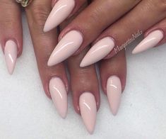 Stiletto nails with beautiful pink light colour
