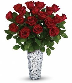 Gorgeous red roses are the classic gift of love. Beautifully presented in an exquisite sparkling glass vase - it's the ultimate gift of love. She'll be speechless.