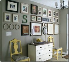 {entry way or loft}Love the horizontal symmetry of this gallery wall, and the unique items added to it like the metal sign.   For long empty wall in living room after Christmas