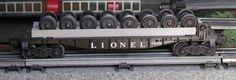 Lionel postwar # 6262 Wheel and axle flatcar.