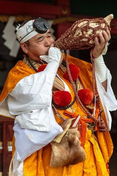 A Buddhist monk Yamabushi welcomes  with his shell trumpet  Horagai.