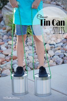Just in time for summer, recycle tin cans into a classic toy -- Tin Can Stilts! {OneCreativeMommy.com} These would be such a fun craft for the Fourth of July!