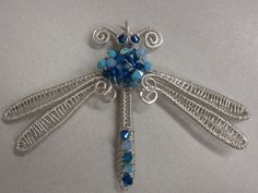 Large Dragonfly Pendant. Hand Forged and Wire Wrapped, with Swarovski Crystals. $50.00, via Etsy - kjs
