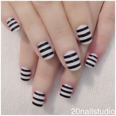 Striped Black and White Nail Design. See more at http://www.naildesignsforyou.com/32-black-white-nail-designs-art/ #nails #black #white #naildesigns #art #nailart