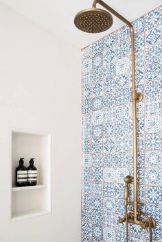 brass shower fixture and blue tile