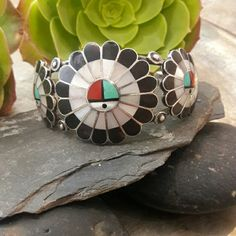 """Circa 50's Zuni  Vintage Sterling Sun God Bracelet Inside circumference is 5 1/4"""" Width is 1 3/8"""" Opening is 1 1/4""""  Not signed, but tested for Sterling Silver. Bracelet is made up of Coral, Onyx, MOP and Turquoise, small chip in Onyx stone it is not noticeable. Zuni Jewelry Bracelets"""