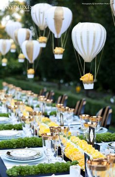 beautiful table with little hot air balloons floating above.