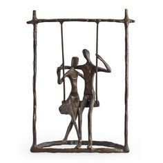 Handcrafted cast bronze sculpture of a couple on a swing. Portrays the power of intimacy and innocent romance.  Lined bottom to protect furniture