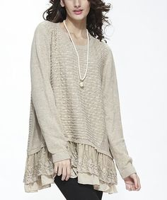 This textured knit sweater features embroidered layers along the hem for a whimsical finish, while offering lasting comfort with its free-flowing fit.
