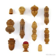 Collection ofhand turned and carved vegetable ivory acorn shaped thimble holders, cylindrical sewing needle cases, thimbles, and pin cushion.Carved from a South Americancoquilla nutand tagua nut.Beautiful range of rich honey colored hues. Part of Glee's collection for 50 years. CONDITION:Overall very good condition. Large and wide needle holder does have crack and chip. Honey Colour, Thimble, Sewing Tools, Glee, Acorn, Pin Cushions, Cases, Carving, Range