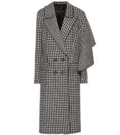 Burberry - Houndstooth wool coat - Fresh off the London runway, Burberry's finely tailored long coat has been fashioned from soft and lightweight houndstooth wool. The sophisticated double-breasted design is enhanced by a wool panel that drapes elegantly across the back of the coat and cascades down the left arm for a fluid, cape-like silhouette. Layer yours over daytime dresses or sharp tailoring for that coveted British look. seen @ www.mytheresa.com