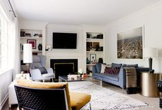Subtle pattern scattered in this modern, midcentury living room // blue sofa