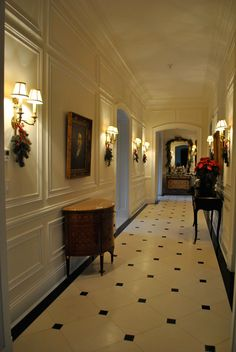 well appointed hallway with wall panels, brass sconces, inlaid cabinet and consul table; Home Room Design, Home Interior Design, House Design, Flur Design, Corridor Design, Deco Retro, Hallway Designs, Enchanted Home, Hallway Lighting