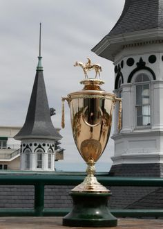 The Kentucky Derby Trophy - The 14 karat gold trophy requires about 2,000 man hours to create, weighs about 60 ounces and is one of the most valuable trophies in sports.