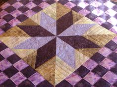 This was a fun quilt. The center star medallion design is by Sherry Rogers Harrison. Quilting by me; Deborah Poole