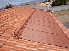 Terracotta-colored Heliocol solar pool heating panels
