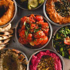 SALATIM (Rapini Tabouleh, Beet Root Relish & Dukkah, Sweet Potato & Sumac, Cranberry Bean Matboucha, Everything Bagel Spice, Tunisian Carrots, Garlic Fried Tomatoes Chopped Eggplant & Tahina.)