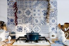 Blue and white mismatched tiles as a backsplash really do something to me.