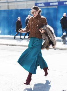 I adore Olivia Palermo's modern-retro take on the trend. She paired rich teal culottes with warm pieces in tones that are perfect for fall. Her cozy knit sweater, faux fur wrap, and burgundy boots work together to create luxurious texture and complete the chic look.