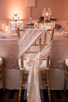 Reception table setting with lace linens, burgandy and blush florals, and uplighting | Black Tie Wedding at the Sheraton Virginia Beach Oceanfront Hotel