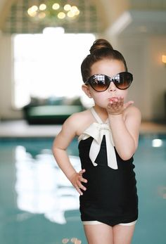 The bathing suit... sunglasses... bun... face... all perfect!