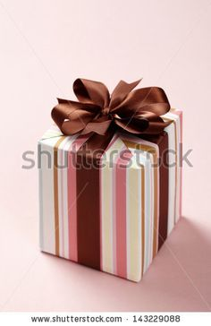 gift box on pink background. Gift box with brown ribbon.