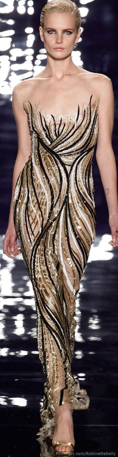 Reem Acra | F/W 2014 RTW: A wonderful example of how curved lines repeated can create a soft flowing rhythm for the outfit.