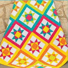 Get the @AccuQuilt  GO! Ohio Star Die to make a Vibrant Ohio Star Quilt like this one. Get the pattern (PQ10310) FREE at AccuQuilt.com.