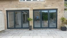 Aluminium Bi Folding Doors available up to wide, inspired by homes of distinction, we have a huge range of styles Bifold Doors Onto Patio, Sliding Door Panels, Patio Doors, Kitchen Extension Layout, House Extension Design, Concertina Doors, Open Plan Kitchen Living Room, Dining Room, Conservatory Kitchen