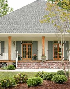 Design by Krista Lewis, K. Photography by Nancy Nolan for At Home in Arkansas. Acadian cottage exterior ~The house colour, the shutter colour and the wood columns. This are the exact exterior colours I want for my next build~B Exterior Paint Colors For House, Paint Colors For Home, Paint Colours, House Shutter Colors, Exterior Shutter Colors, Cottage Exterior Colors, Exterior Paint Ideas, House Siding Colors, Outdoor House Colors