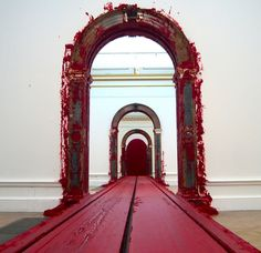 Anish Kapoor - The centrepiece of the Royal Academy exhibition - the 'paint train' – a 30-tonne block of wax, paint and Vaseline that runs back and forth through five empty galleries, covering them in a trail of blood red
