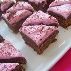 """Raspberry Fudge Brownies   """"These moist chocolate brownies are topped with a rich fudge layer and a fluffy raspberry cream cheese frosting. To make them even prettier, I like to garnish them with chocolate curls."""""""