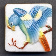 I found this beauty on eBay.  (It's a Buy It Now.)  Vintage Japanese Toshikane Arita Exotic Bird Button