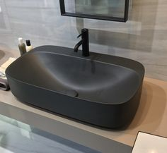 Matt black basin and black mixer bathroom tap by Porcelanosa...