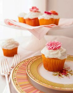Dress up old-fashioned cupcakes with a sweet treat: crystallized edible posies.   - CountryLiving.com