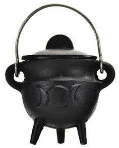 """A black, cast iron cauldron with a triple moon symbol raised from the surface on the outside of the bowl. Cast Iron. 2 3/4"""" x 3"""""""