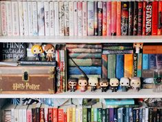 fiderlyreads:    Another section of my shelves organized by series and the bottom shelf is paberbacks I have yet to read.