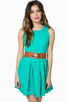 A sweet and cute flare dress featuring a ribbon knit construction and a box pleated skirt. Round neck. Sleeveless. Exposed back zip closure. Belt loops at the waist with a wide leatherette belt. Finished short hem. Unlined.