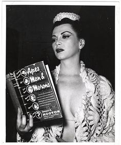 Sherry Britton Reading Apes, Men and Morons c. 1944