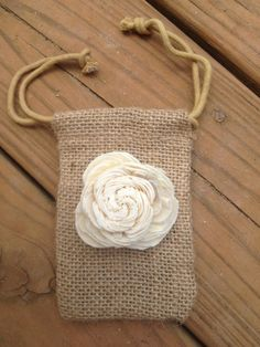 Cute idea for party favor bag   https://www.etsy.com/listing/120731708/3x5-burlap-bag-with-sola-flower-shabby