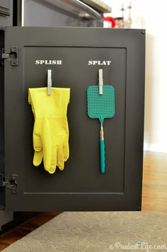 This seriously simple solution also comes courtesy of Polished Habitat: Stick a few clothespins to the inside of the cabinet door to stash and grab just about anything, whenever you need it.