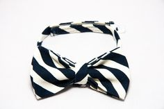 This navy blue and white stripe bow tie is perfect for a christening, wedding or photoshoot. Lime Hippo creates dapper, stylish and downright cool clothing for children. Use the code PINTEREST for 10% off in our shop.